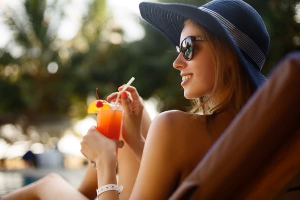 Resident enjoying a drink poolside at Remington Ranch in Litchfield Park, Arizona