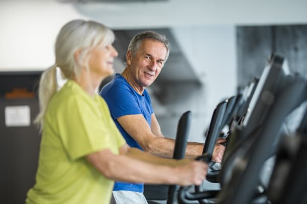 Residents in the fitness center at Villa Grande on Saxon in Orange City, Florida