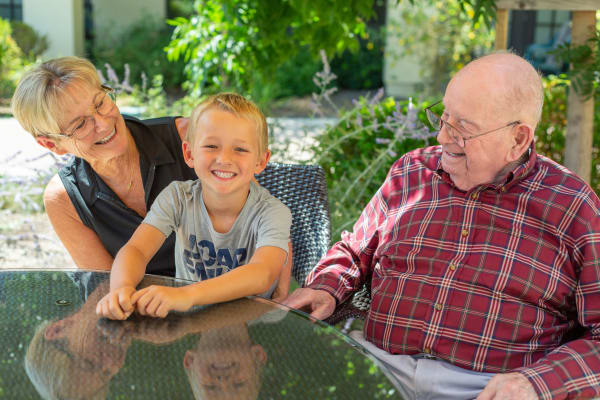 Senior citizen enjoying a moment with her grandson at Merrill Gardens at West Covina in West Covina, California