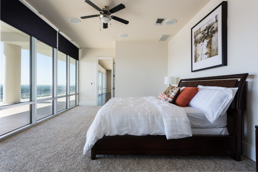 Modern decorated master bedroom at The Heights at Park Lane in Dallas, Texas