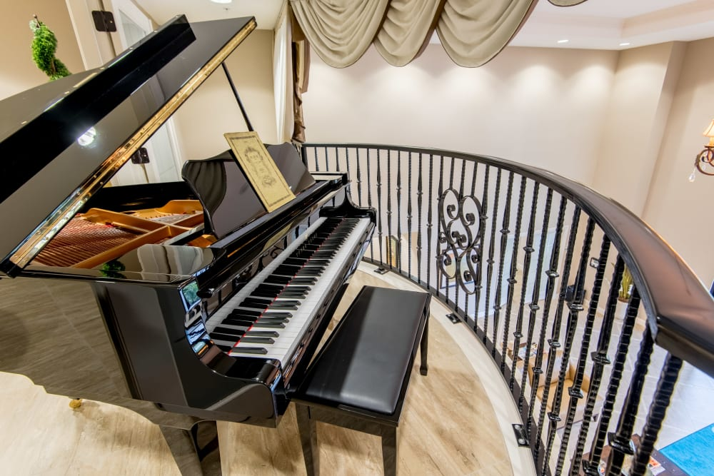 Community room with a piano at Inspired Living at Lakewood Ranch in Bradenton, Florida.