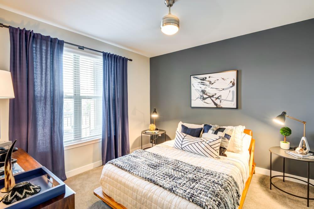 Comfy and naturally lit bedroom at Flats At 540 in Apex, North Carolina