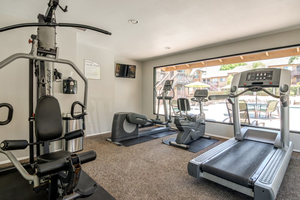 Fitness center with plenty of individual workout stations at Hillside Terrace Apartments in Lemon Grove, California