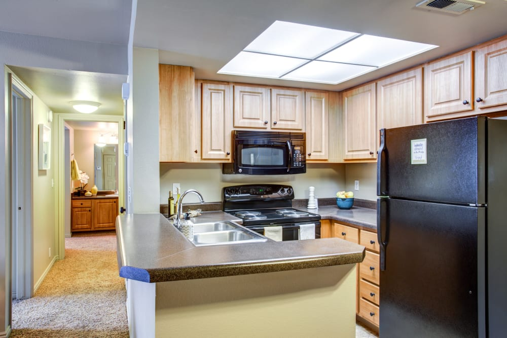A kitchen and hallway at Royal Farms Apartments in Salt Lake City, Utah