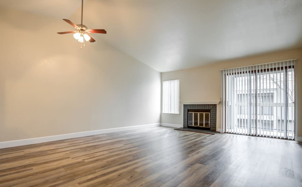 Bright and spacious living room at Waterfield Square Apartment Homes in Stockton, CA