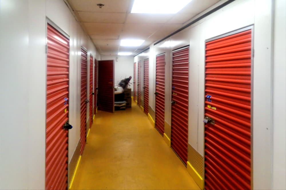 Clean indoor hallway of storage units at Prime Storage in Boston, Massachusetts