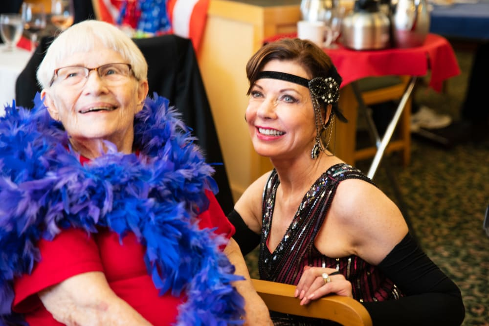 Resident having fun at Puget Sound Honor Flight Fundraiser at Merrill Gardens at Renton Centre in Renton, Washington.