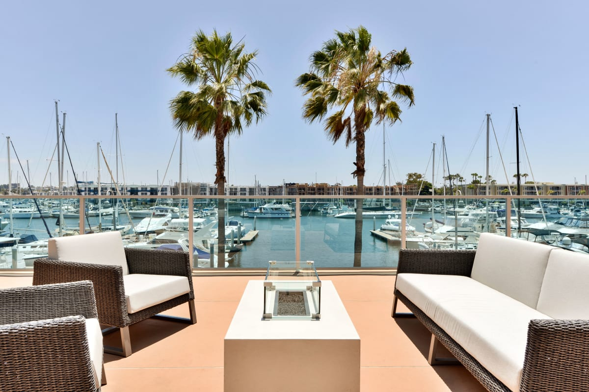 Outdoor lounge area with a view of the marina at Esprit Marina del Rey in Marina del Rey, California
