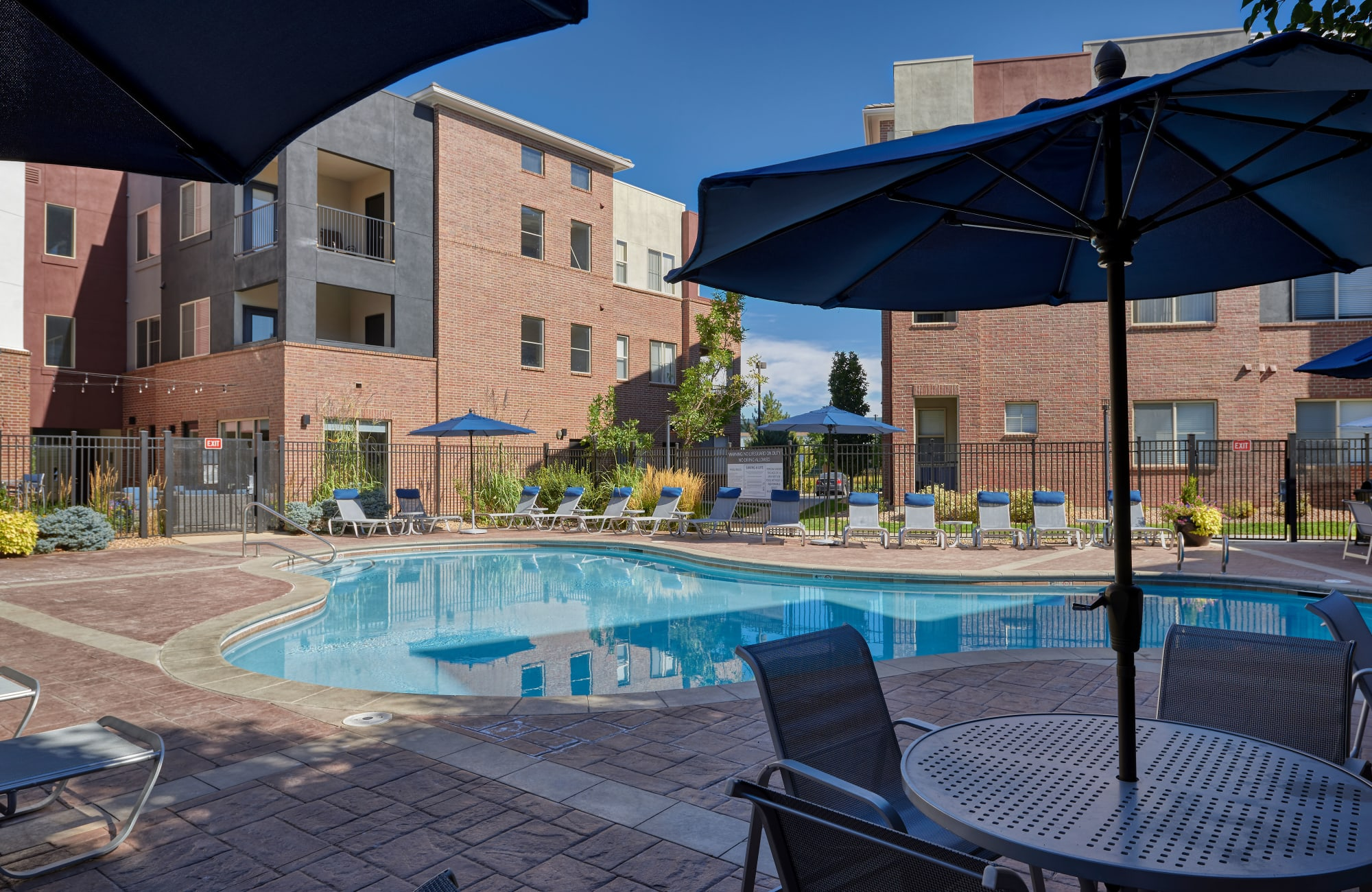 Spa and Pool with lounges and umbrellas in Englewood, CO
