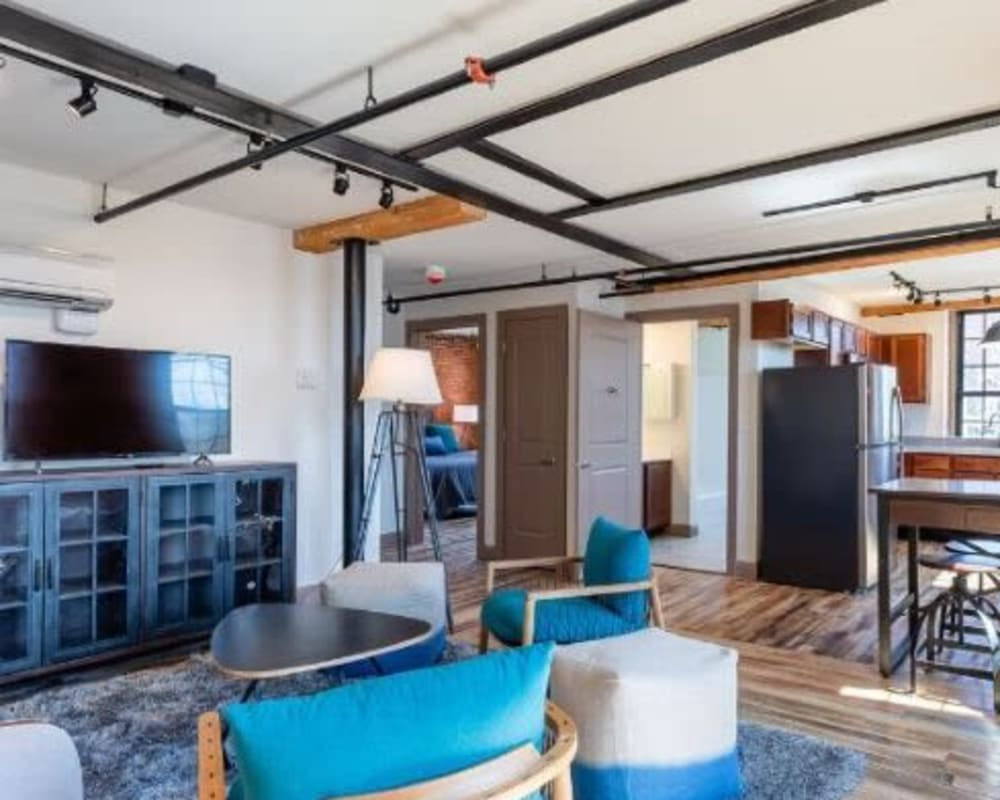 Spacious living room with wood style flooring at Lofts at Cargill Falls Mill in Putnam, Connecticut