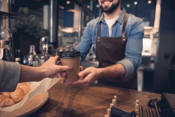 Barista serving coffee near South Meadow in Ames, Iowa.
