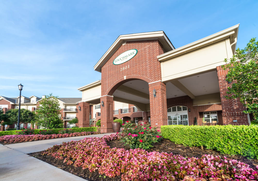 The main entrance and apartment exterior at Touchmark at Coffee Creek in Edmond, Oklahoma