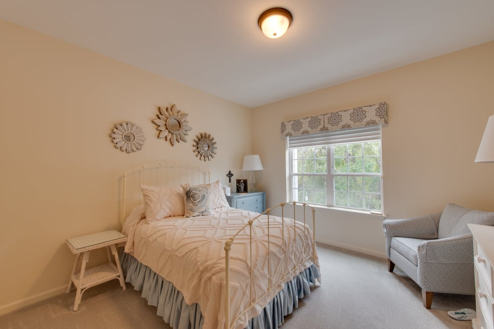 A spacious, decorated bedroom at Harmony at Harbour View in Suffolk, Virginia