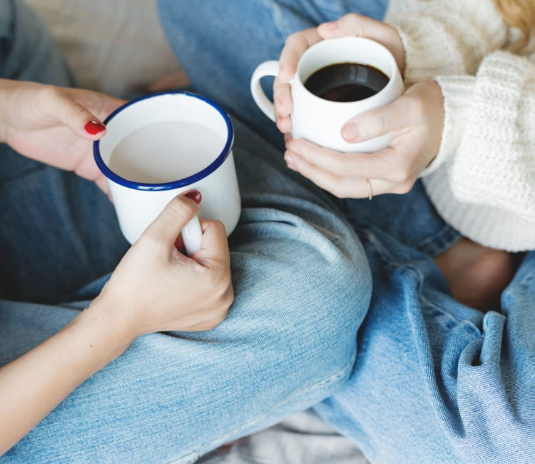 Residents enjoying their morning coffee together in their new home at Harbor Point Apartments in Mill Valley, California