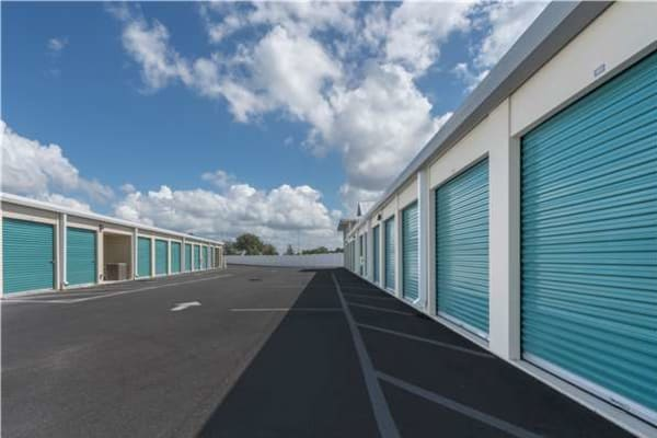 Storage units with blue doors at Midgard Self Storage in Bradenton, Florida