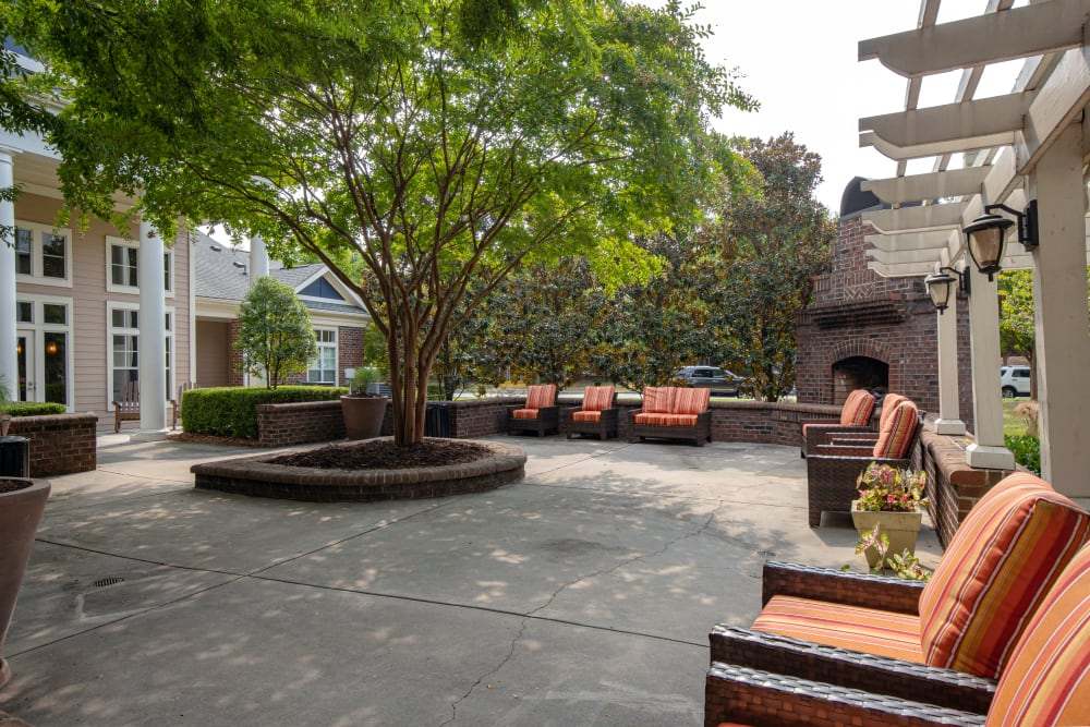 Community courtyard with fireplace and chairs at Preserve at Steele Creek in Charlotte, North Carolina