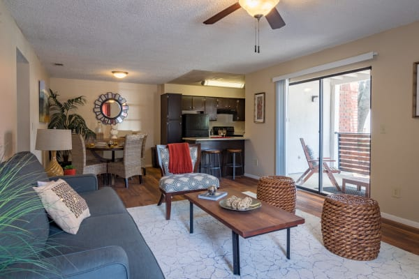 Furnished living room and dining area at Presidio Apartments in Allen, Texas
