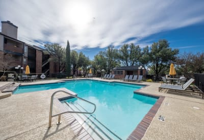 Enjoy a shimmering swimming pool at Trails of Towne Lake in Irving, Texas