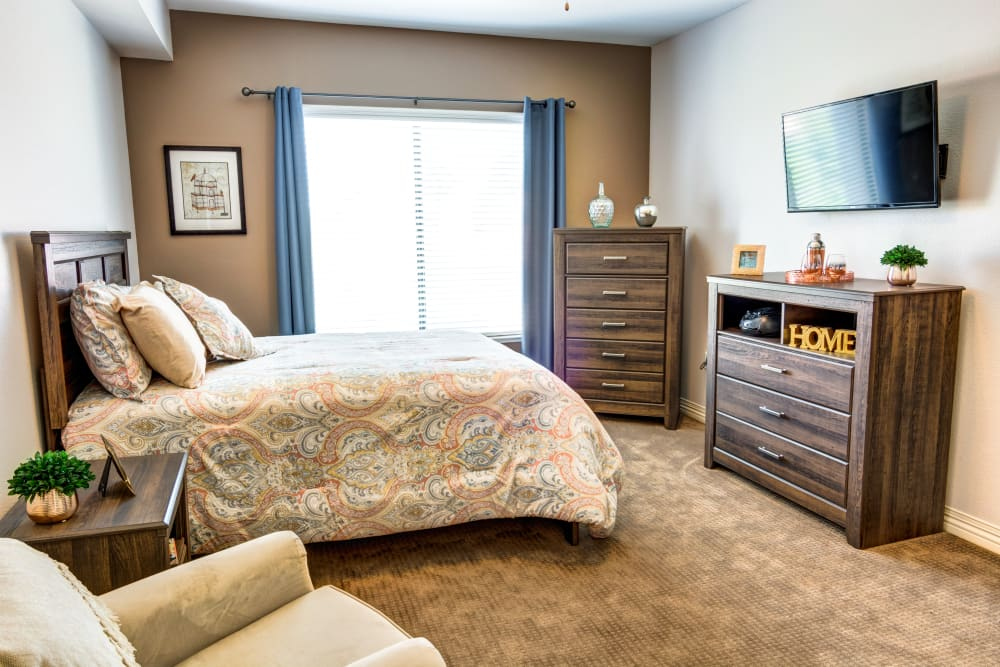 A bed in a studio apartment at The Wentworth of Las Vegas in Las Vegas, Nevada