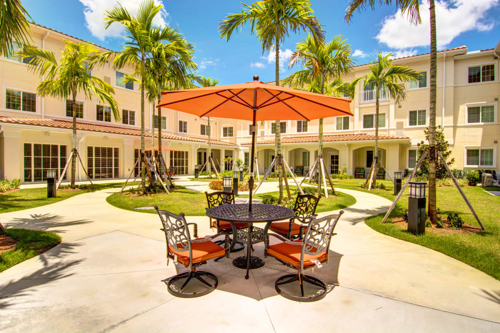 Outdoor table set for four at The Meridian at Boca Raton in Boca Raton, Florida
