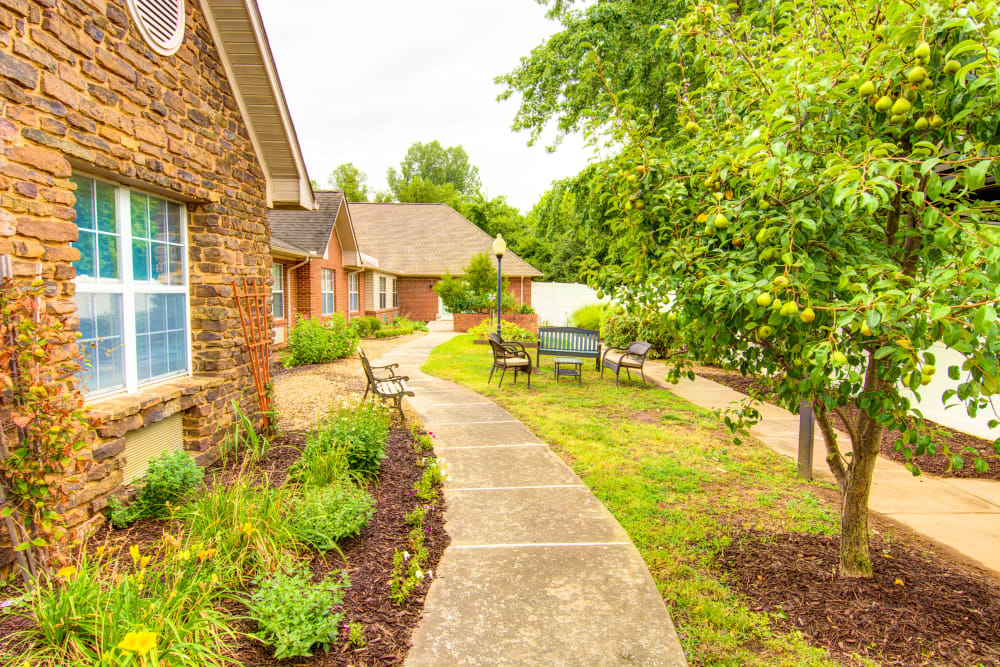 Walking path and benches at Brookstone Assisted Living Community in Fayetteville, Arkansas.