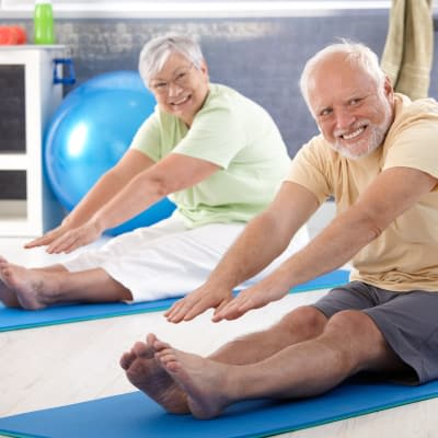 Senior couple stretching at Stonecrest at Clayton View in Saint Louis, Missouri