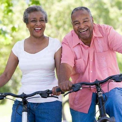 Couple on bike at Orchard View Senior Apartments in Rochester, New York