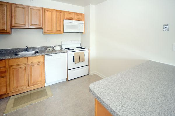 Kitchen spacious at The Colonials Apartment Homes