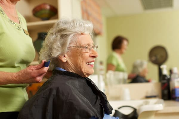 Senior citizen receiving a haircut at Discovery Commons At Wildewood in California, Maryland.
