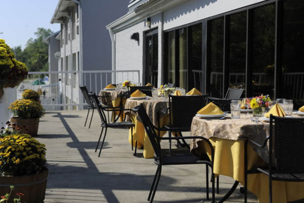 Deck with dining seating at Willow Creek Senior Living in Elizabethtown, Kentucky.