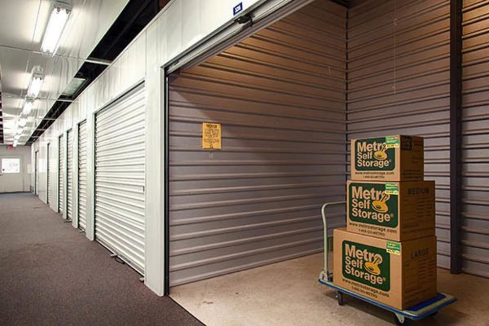 Open indoor unit with packages at Metro Self Storage in Kingwood, Texas