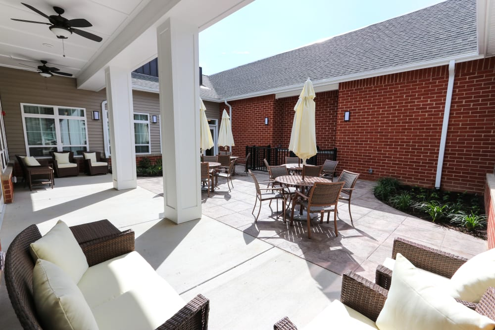 Covered outdoor seating at The Harmony Collection at Roanoke - Memory Care in Roanoke, Virginia
