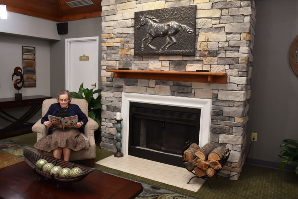 Resident relaxing by the fireplace at Willow Creek Senior Living in Elizabethtown, Kentucky.