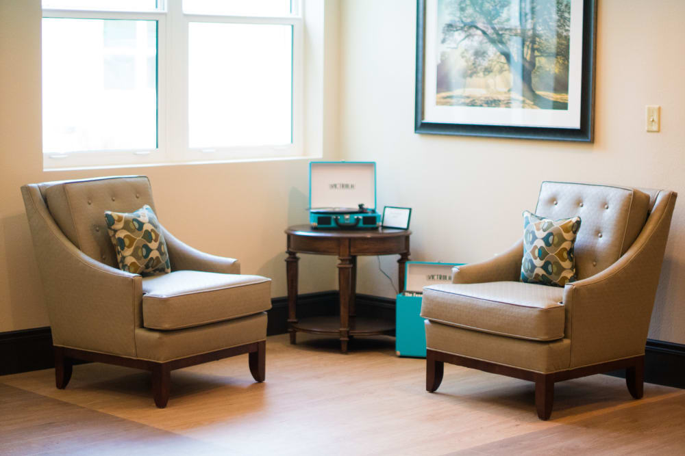 A comfy seating corner at CERTUS Premier Memory Care Living.