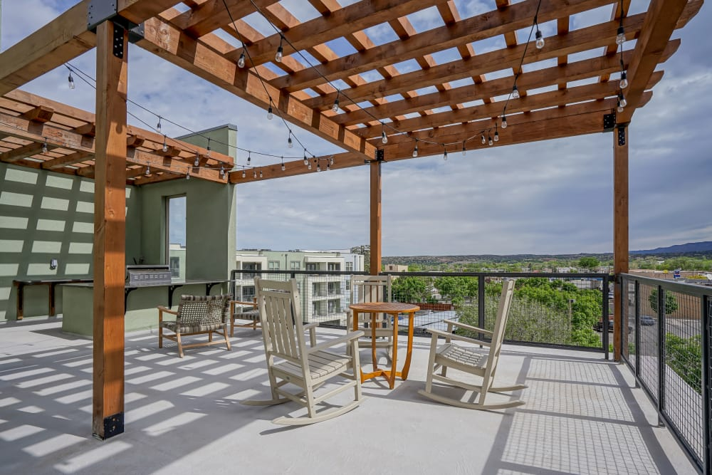 Beautiful deck seating with views of the city at Capitol Flats in Santa Fe, New Mexico