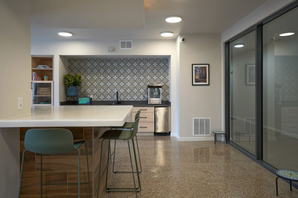 Community area with kitchen at Capitol Flats in Santa Fe, New Mexico