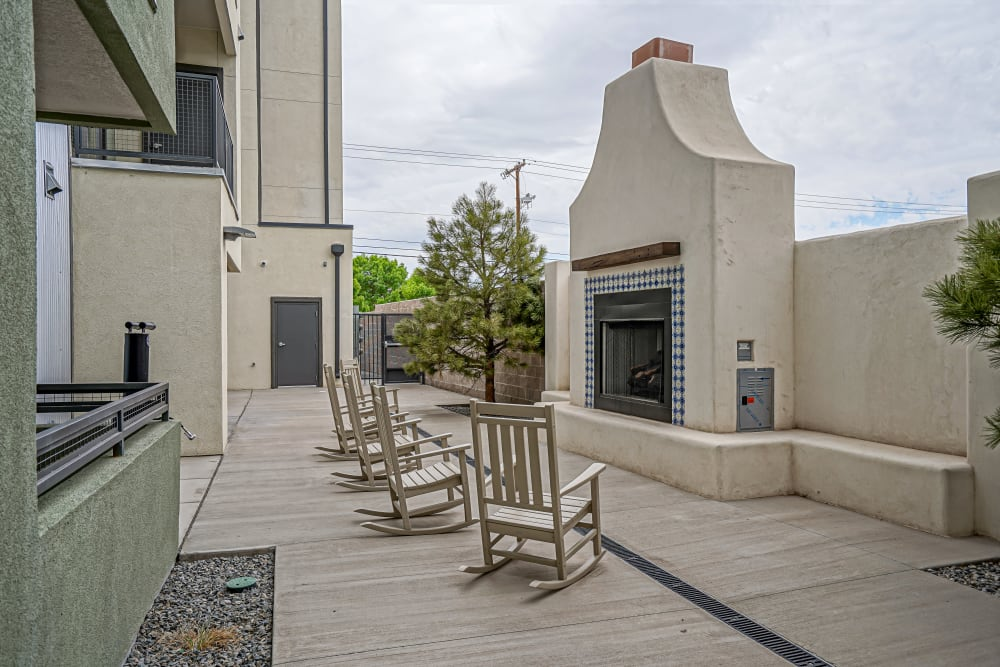 Community outdoor seating area and fireplace at Capitol Flats in Santa Fe, New Mexico