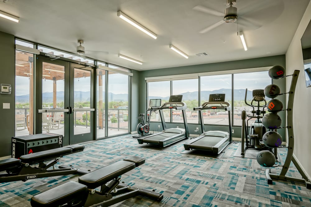 Well-equipped fitness center with a gorgeous view at Capitol Flats in Santa Fe, New Mexico