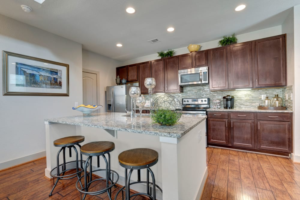 Kitchen with stainless steel appliances at Arrabella in Houston, Texas