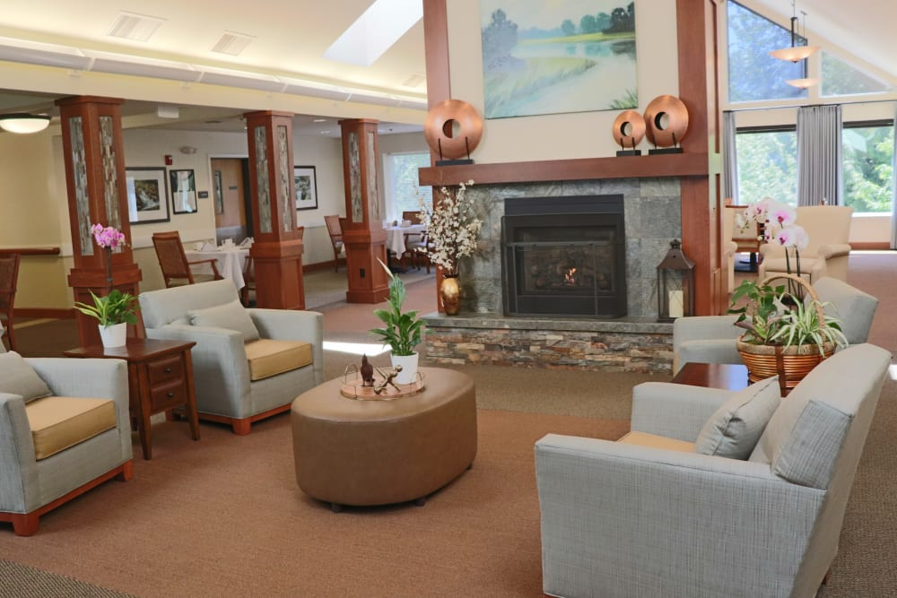 Comfortable community lounge area with fire place at The Springs at Carman Oaks in Lake Oswego, Oregon
