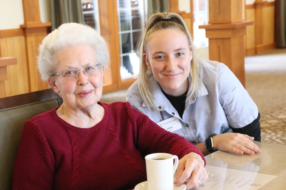 Resident and caregiver enjoying coffee at The Springs at Missoula in Missoula, Montana.