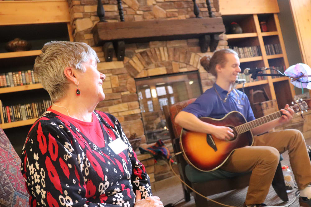 Resident enjoying music provided by caregiver at The Springs at Missoula in Missoula, Montana.