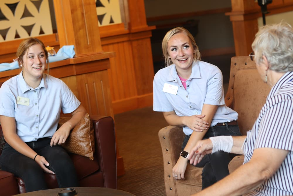 Resident and caregivers chatting in lounge area at The Springs at Missoula in Missoula, Montana.