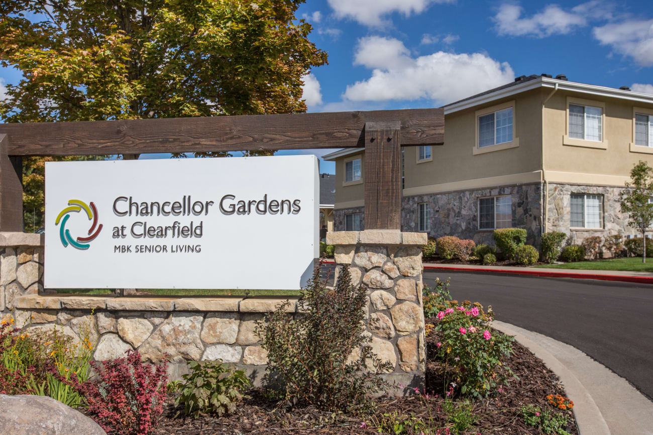 Welcome sign at Chancellor Gardens in Clearfield, Utah