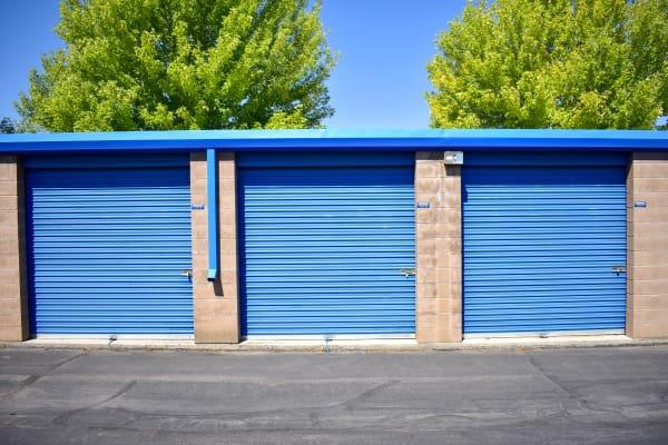 Big green trees behind exterior storage units at STOR-N-LOCK Self Storage in Cottonwood Heights, Utah