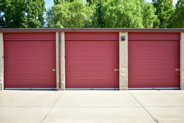 Outdoor storage units with red doors at STOR-N-LOCK Self Storage in Rancho Cucamonga, California