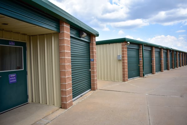Exterior storage units with forest green doors at STOR-N-LOCK Self Storage in Littleton, Colorado