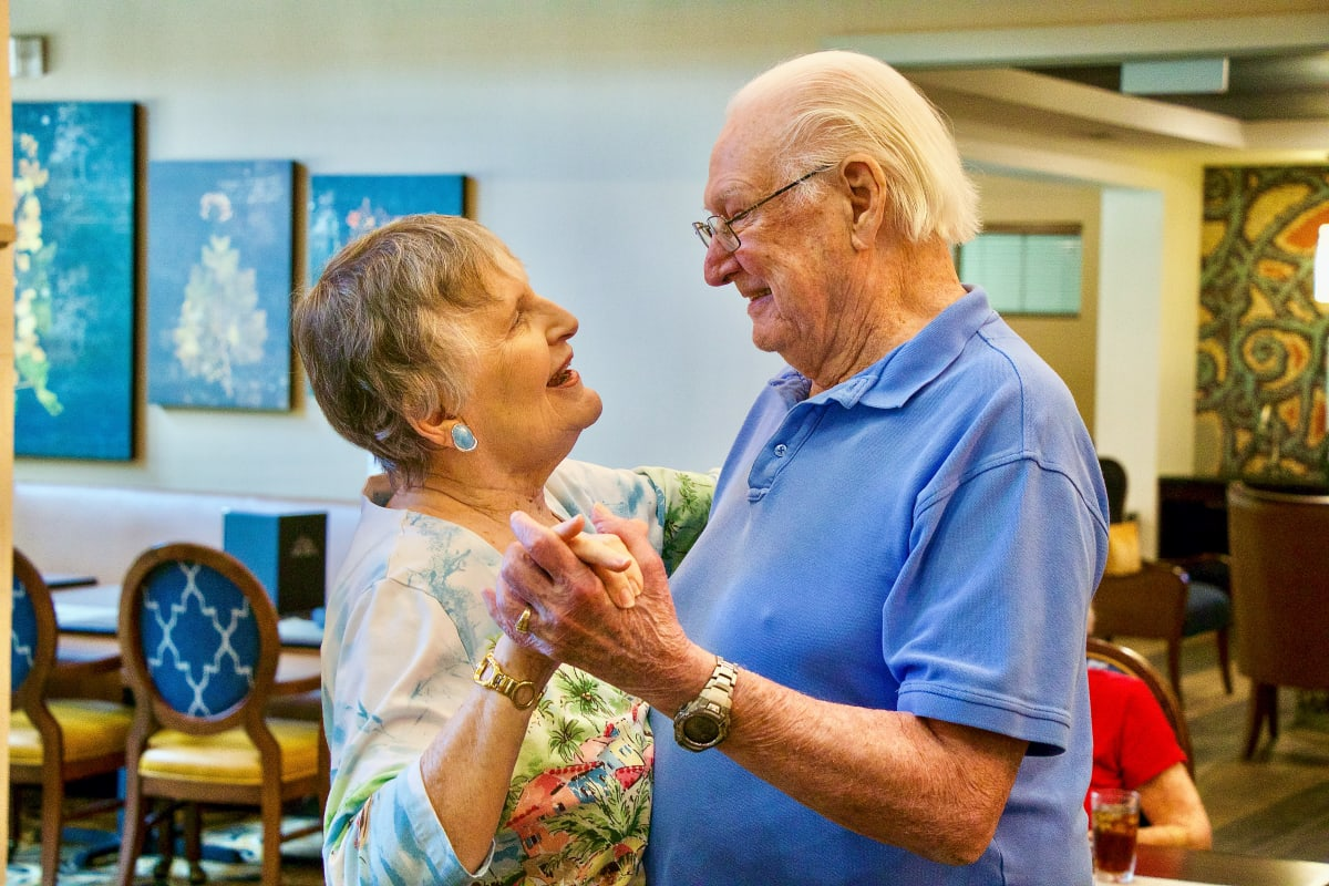 Couple dancing at an Integrated Senior Lifestyles community