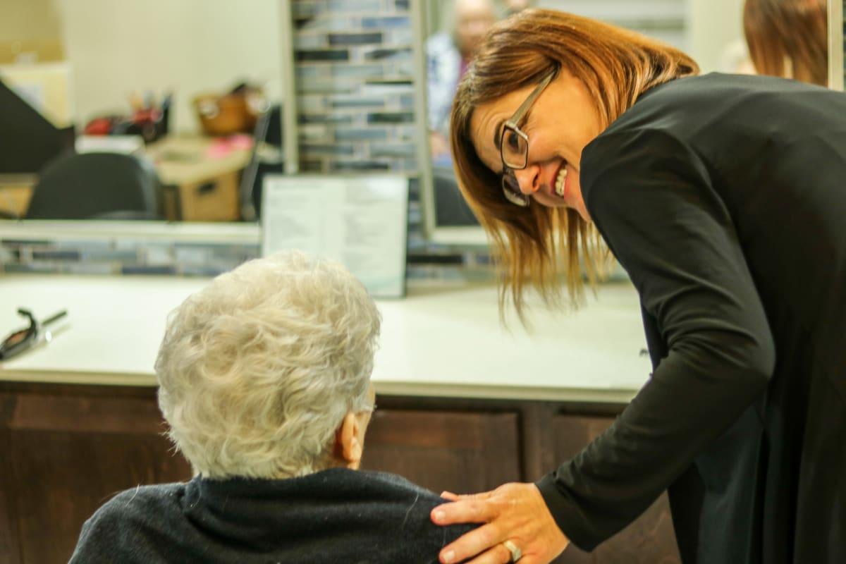 Resident being assisted by staff member at Watercrest at Mansfield in Mansfield, Texas