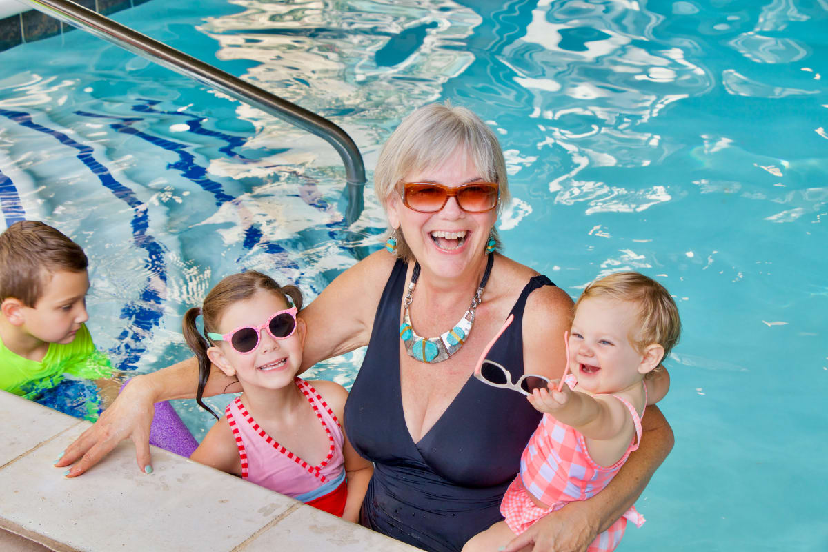 Resident with her grandchildren at Watercrest at Shadow Creek Ranch in Pearland, Texas